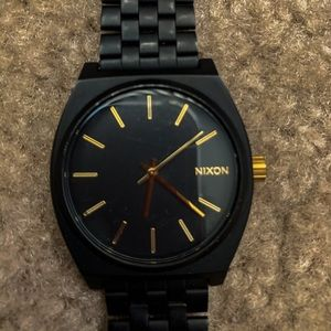 Black and Gold Nixon Watch